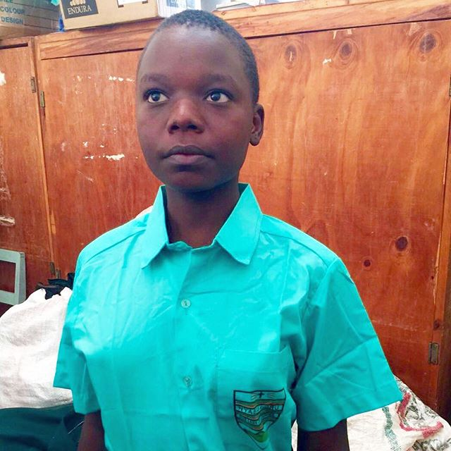 13 year old Zainabu standing in her dignity in her new National secondary school uniform. Education will change her life. #LetGirlsLearn