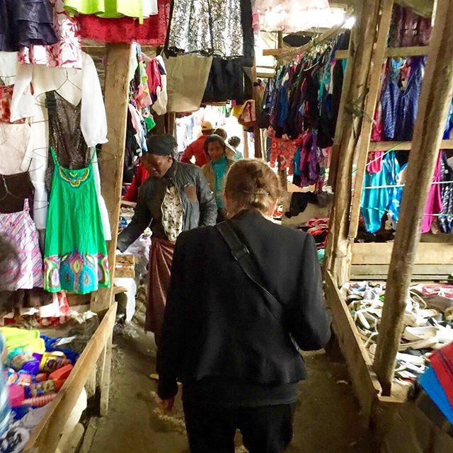 We make sure each of our students has all the school supplies they will need. Here is Shiella shopping for school supplies in a market in Nairobi.