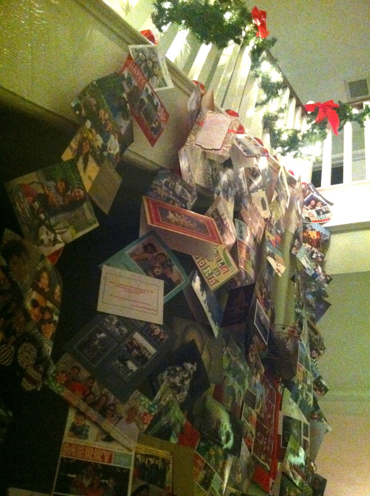 One of our family traditions: hanging Christmas cards we receive on thick ribbon along the staircase. All cards are prayed for over dinner by the family before we hang them up.