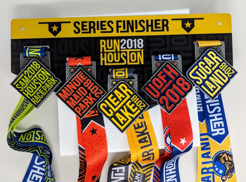 2018 Run Houston! Race Series Finisher medal display. Full color print on aluminum, medals mounted with double-sided foam tape.