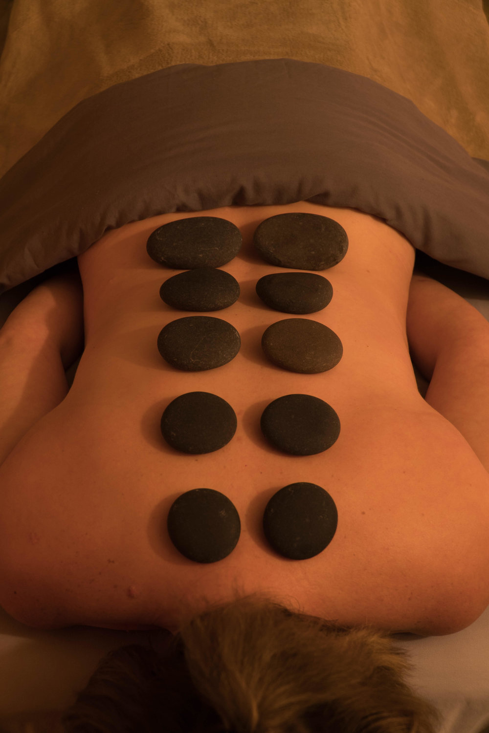 Rock N' Roll Massage, also known as Hot Stone Massage. Provided by Tamara.