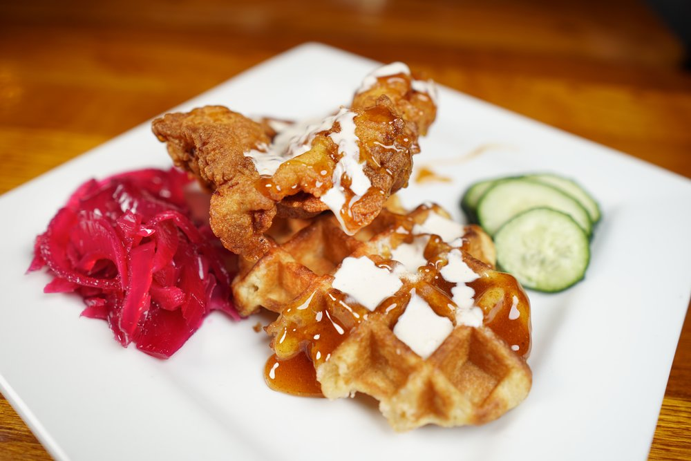 Chicken & Waffles - topped with spicy honey syrup and Datil ranch drizzle