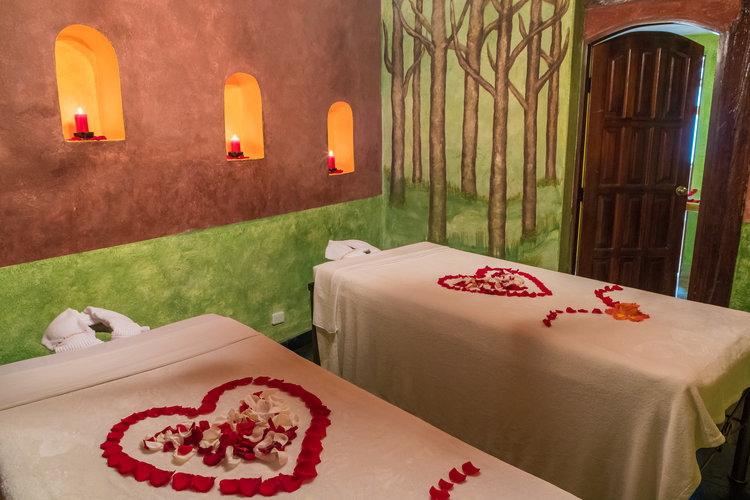 LOVE IN THE FOREST - Sala Madera, private room.Includes: 1 full body massage per person (1h.), 1 chocolate exfoliation per person, use of jacuzzi with mineral salts and bath foam, roses petals decoration, season juice.Duration: 2h.$198 / 2 people.