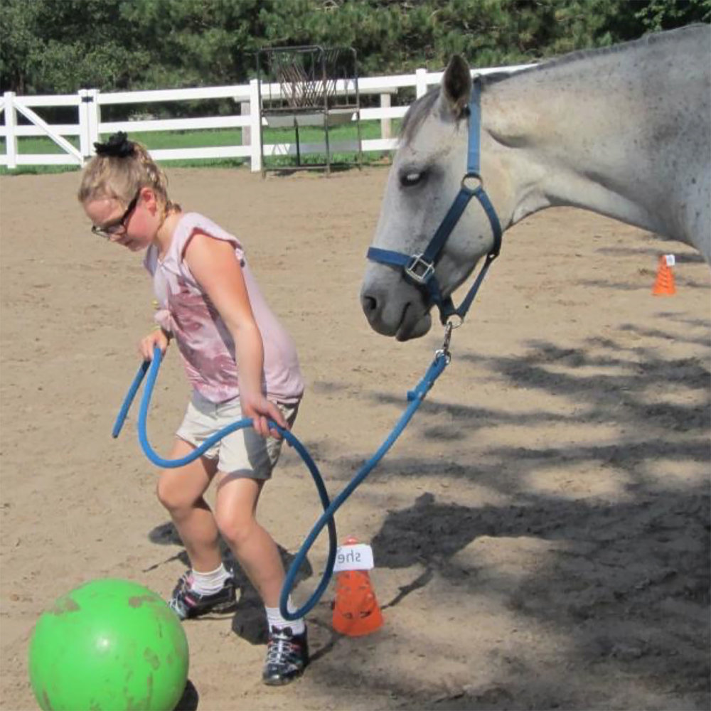 girl.rope.learning.word.soccer.horse.jpg