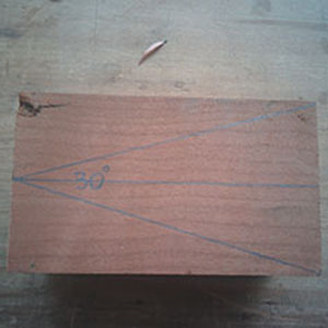 2. A block of cherrywood has been marked out with a 30 degree wedge