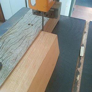 11. A block of quarter-sawn western red cedar is sawn into strips 1.0mm thick