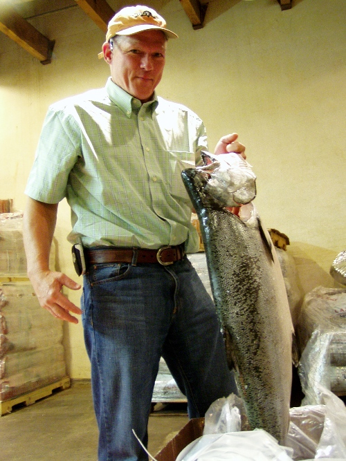 Newman's Fish Co. John Cleary holding a Southeast Alaska chinook just after arrival from PDX airport