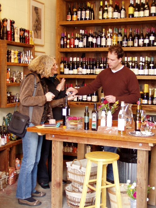 Owner Mark Bitterman sampling wine and salt with customers
