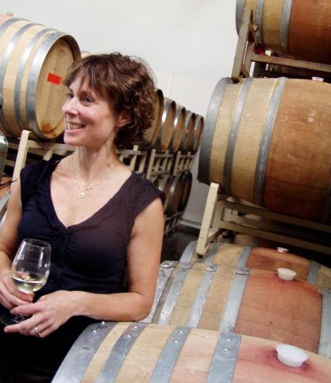Athena Pappas of Boedecker Cellars in the barrel room.
