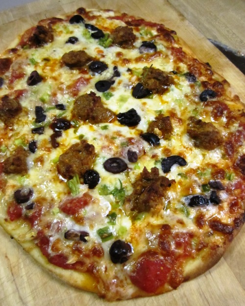 They went onto this chorizo pizza with homegrown tomato sauce, olives, scallions and lots of garlic.