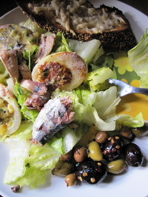Summer salad with stuffed/fried hardboiled egg, anchovies, olives and a lemony mustard vin.