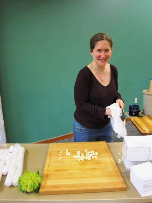 Heidi Nestler chopping up garlic for kraut.