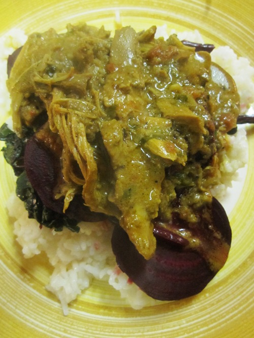 Chicken curry with beets and beet greens over basmati.