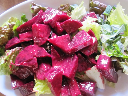 Beet salad inspired by Evoe's with a creamy Dijon vinaigrette tossed with herbs from garden and green leaf.