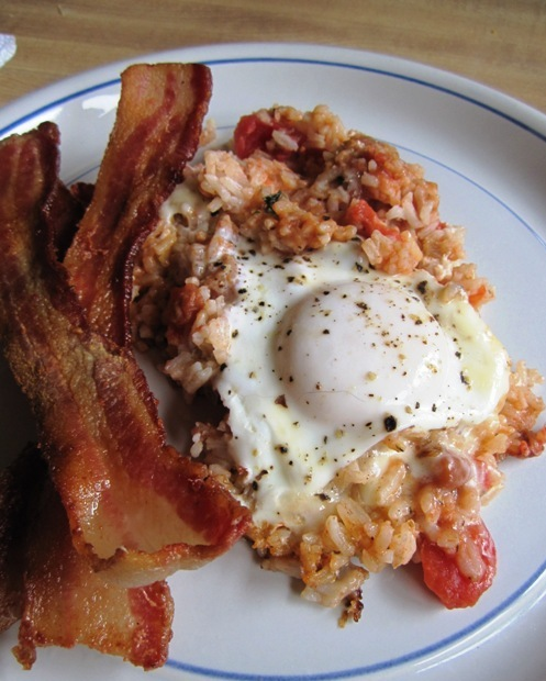 Spanish rice and beans with basted egg and bacon.