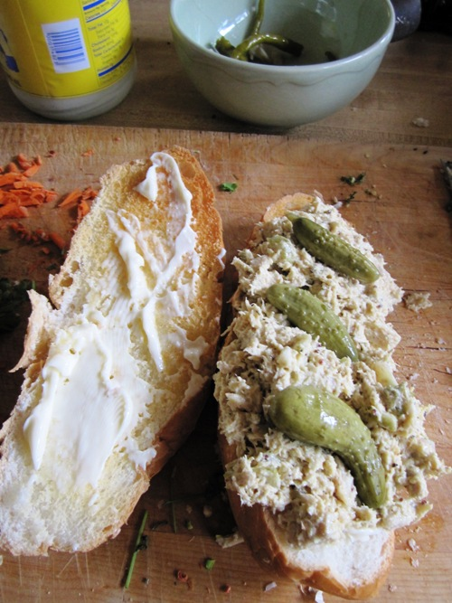 Mustardy tuna salad sandwich with homemade cornichons.