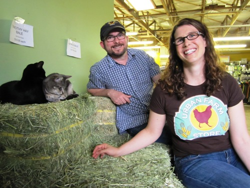 Urban Farm Store owners Hannah and Robert Litt with their shop kitties.
