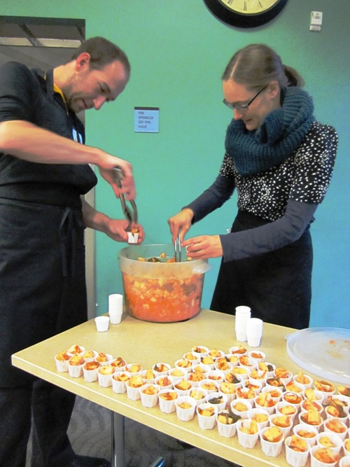 Biwa chef-owner Gabe Rosen and Kina Voelz serving up Biwa's hurts so good spicy daikon kimchi.