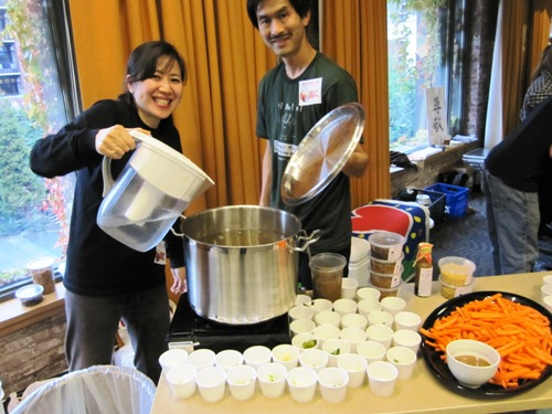 Earnest and Sumiko Migaki of Jorninji Miso cooking up a stockpot of their amazing miso, and sampling miso sauce and amazake made with their own koji.