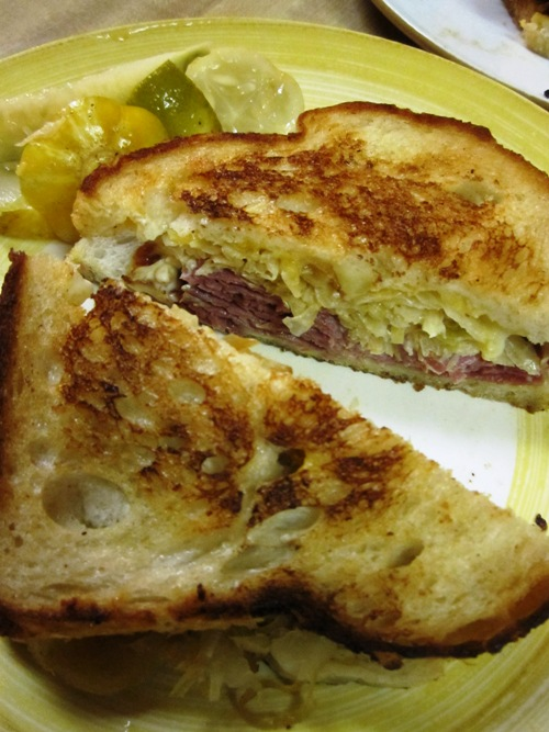 Reuben with corned beef on sourdough (shhh, don't tell) with homemade spicy garlic lemon cuke pickles.