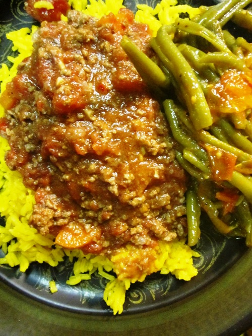 Spicy minced elk over turmeric rice with slow cooked green beans.