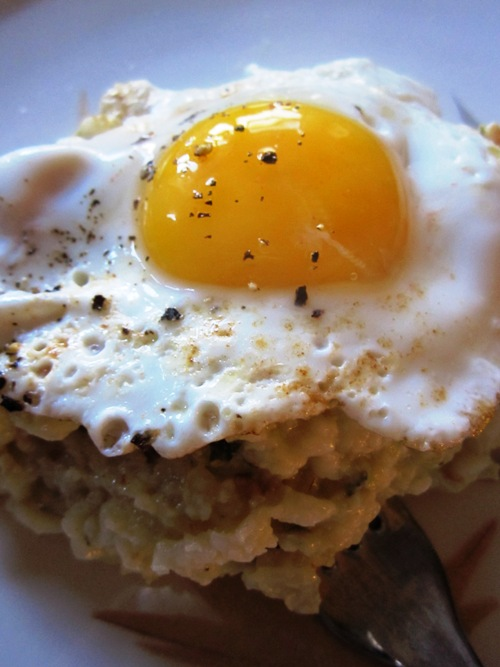Breakfast doesn't get much better than this -- sunny side up over chanterelle risotto.