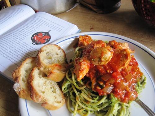 Chicken cacciatore over spaghetti with arugula hazelnut pesto.