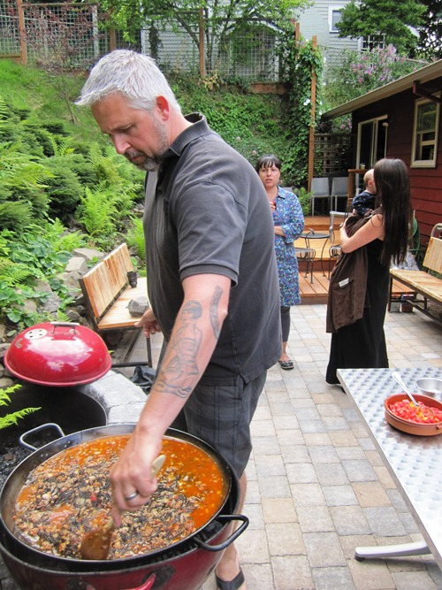 Toro Bravo's John Gorham cooking up some incredibly delicious back patio Rabbit Sausage Squid Ink Fideos for the Toro Bravo Cookbook.