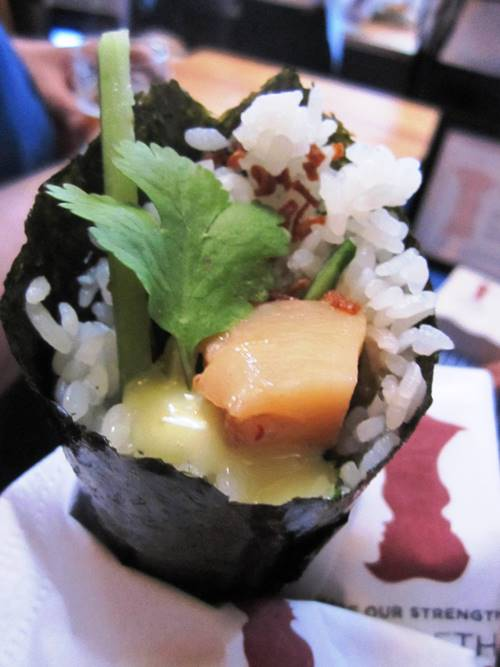 Departure's grilled scallop hand roll with coconut miso.