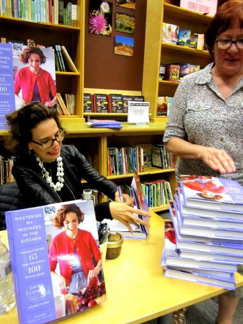 After Dana talked with folks and signed allllll the audience copies Renee from Powell's asked her to sign a bunch of store copies. Finger cramps!
