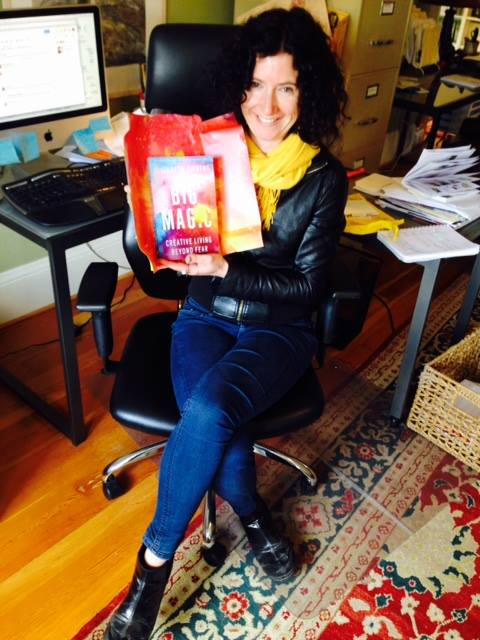 Me holding my advance copy of Elizabeth Gilbert's forthcoming Big Magic when it arrived at the Hawthorne Books office.