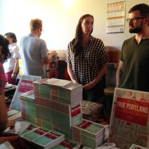 Hawthorne Books interns Stephen Hyde and Melina Hughes slinging books. Cheers to these two and True Portland!