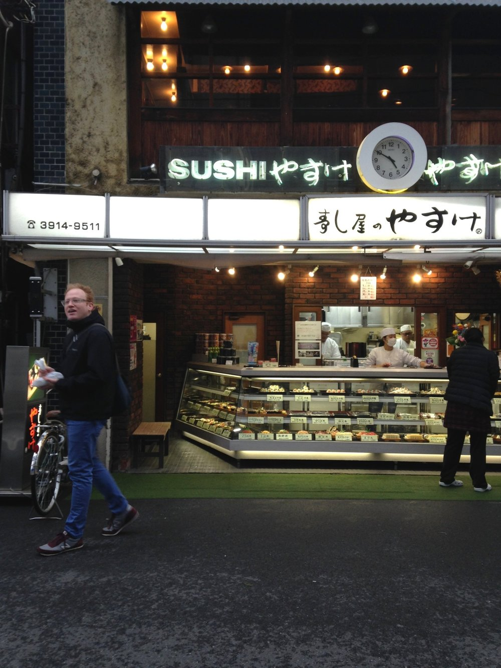 Before we caught our subway back south to our Suidobashi/Jimbocho hotel in the evening Jimbo and I grabbed a couple tasty handrolls here -- tuna and uni. YUM!