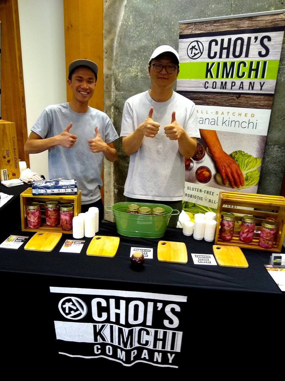 Every year before we open the festival doors I like to try to get as many exhibitor photos as possible. I didn't manage to get as many as I usually do this year — running around — but I got this cute one of Choi's Kimchi!