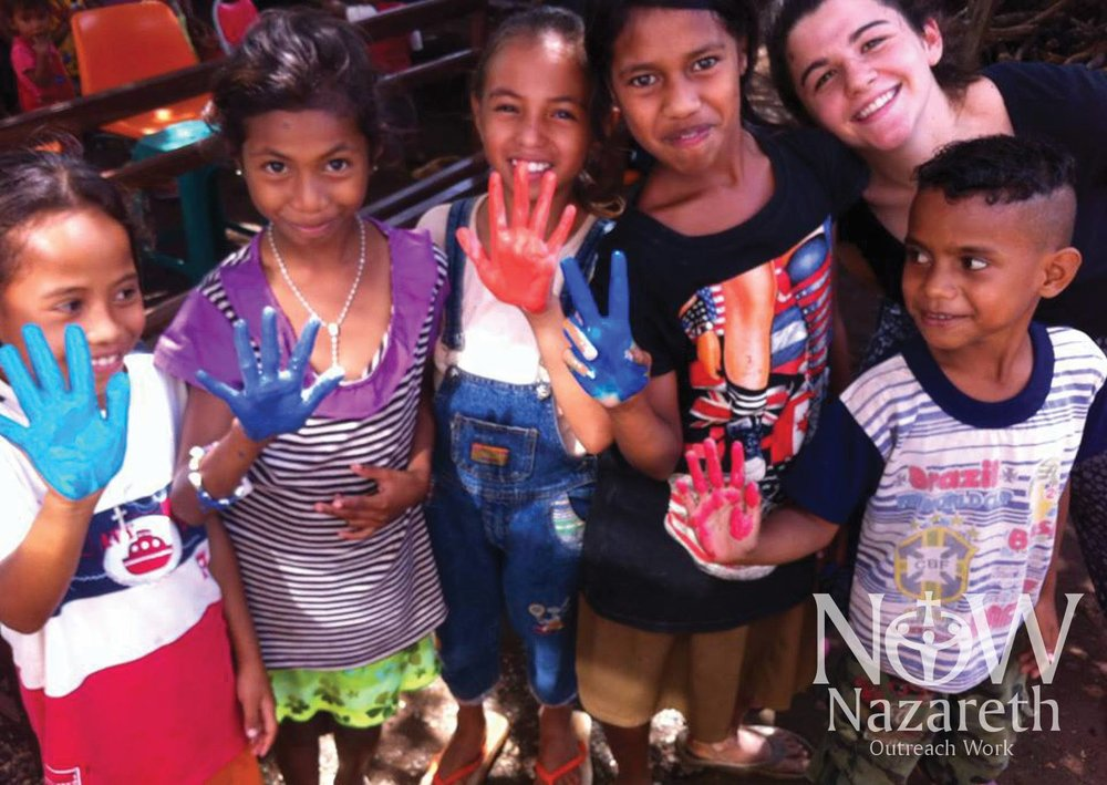 A world wide family -  Nazareth Outreach Work (NOW) was established because it is important to offer help to those less fortunate. In 2012 the first group of young adults and staff travelled to Timor-Leste to work with the Good Crocodile Foundation in the village of Triloka, 130 kilometres from Dili. While they were there community buildings were built and repaired, school activities organised and important initiatives in health begun. In addition money was donated for the construction of a Birthing House and Mother and Child Clinic which was completed in late 2013. Over the following years a number of trips have been made bringing more developmental assistance to help the community overcome poverty and health problems. The quality of life has been improved enormously. But above everything, the most important thing has been the developing of relationships between the community and the NOW team. Our Timorese friends have become family to us.
