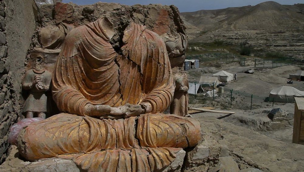 "Afghan Archaeologists Risk Lives to Save Ancient Buddhist City  - Mes Aynak is a site 40 km southeast of Kabul, which contains Afghanistan's largest copper deposit. It also houses the remains of an ancient buddhist settlement with over 400 Buddha statues, stupas and a100 acre monastery complex.In 2007, a 30-year lease was granted to a mining company. The ancient Buddhist ruins, along with irreplaceable historical treasures, were scheduled to be destroyed. Racing against time, and against the threats of taliban abductions, landmines, and insurgents from Pakistan, Afghan archaeologists risk their lives daily to preserve and uncover the priceless cultural heritage of the ancient Buddhist city before it is obliterated by mining operations.  Courageous story told in documentary ""Saving Mes Aynak,"" a documentary directed by Brent Huffman, tells the story through of lens of Qadir Temori, the head of the Afghan archaeological department in Kabul. Huffman explains that Temori is ""braving all of this risk and being very courageous, going against the Taliban, going against this Chinese mining company, going against the bureaucracy in the country to try to save essentially the cultural heritage of Afghanistan... The heart of the fllm is really this story of Afghan archaeologists risking their lives'"