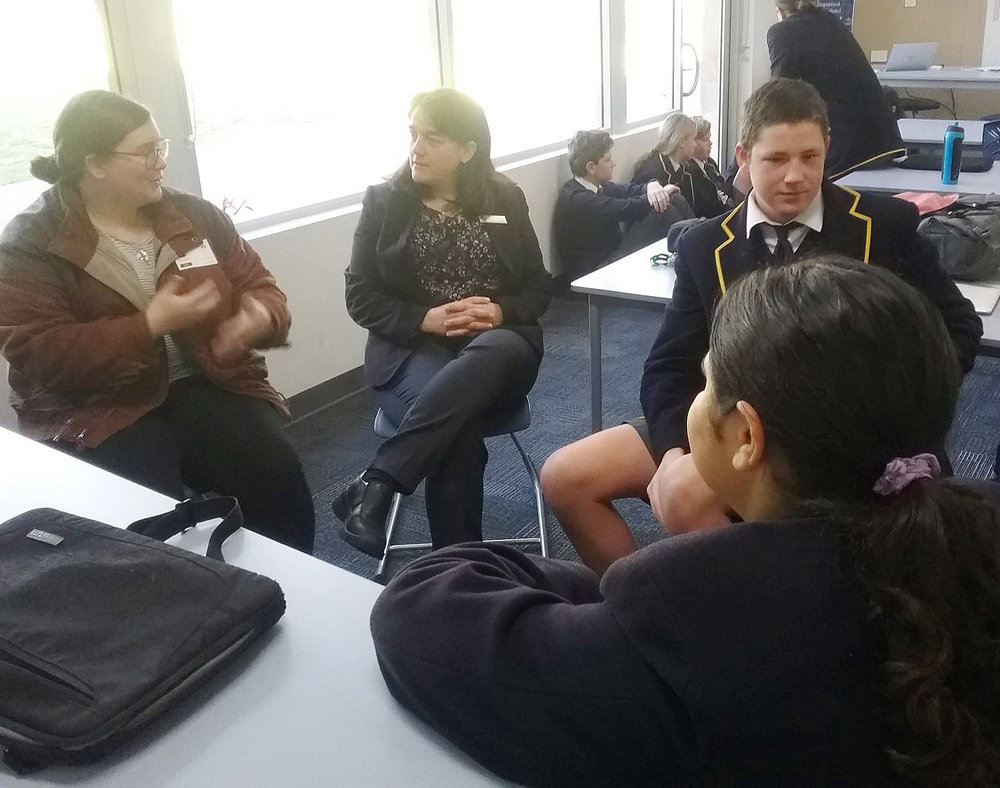 Maisie leads small group discussion with a class of year 9s