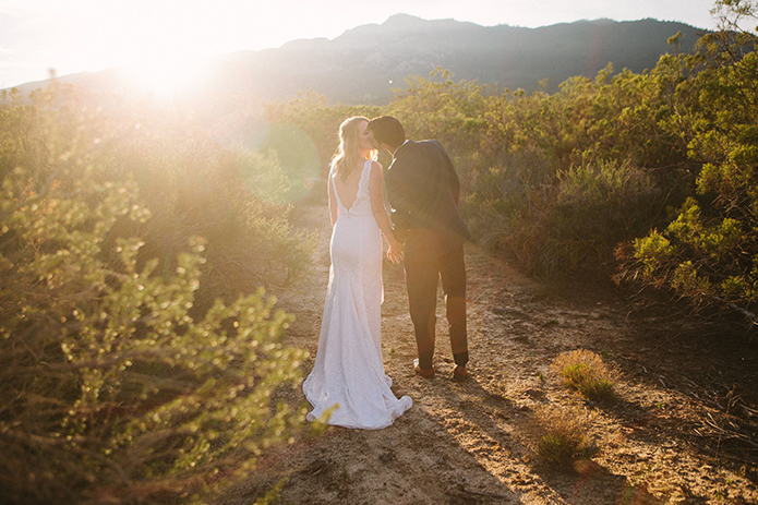 Anza-valley-wedding-at-the-alpaca-farm-bride-and-groom-kissing-at-sunset.jpg