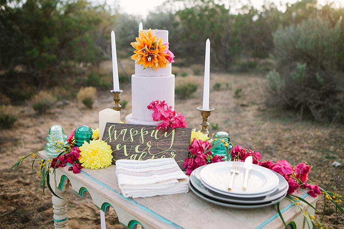 Anza-valley-wedding-at-the-alpaca-farm-wedding-cake-with-orange-and-pink-flower-decor-and-wood-sign.jpg
