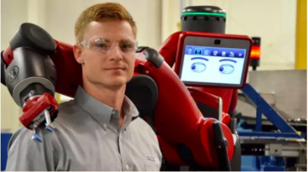 """写真 : Financial Times  Meet the  cobots : humans and robots together on the factory floor """"より"""