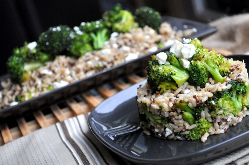 a bowl of broccoli, rice and quinoa