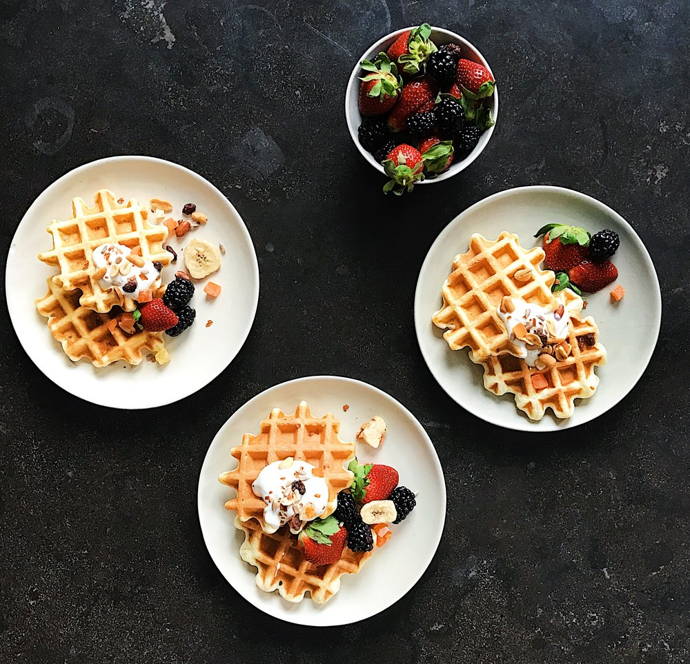 three plates of waffles