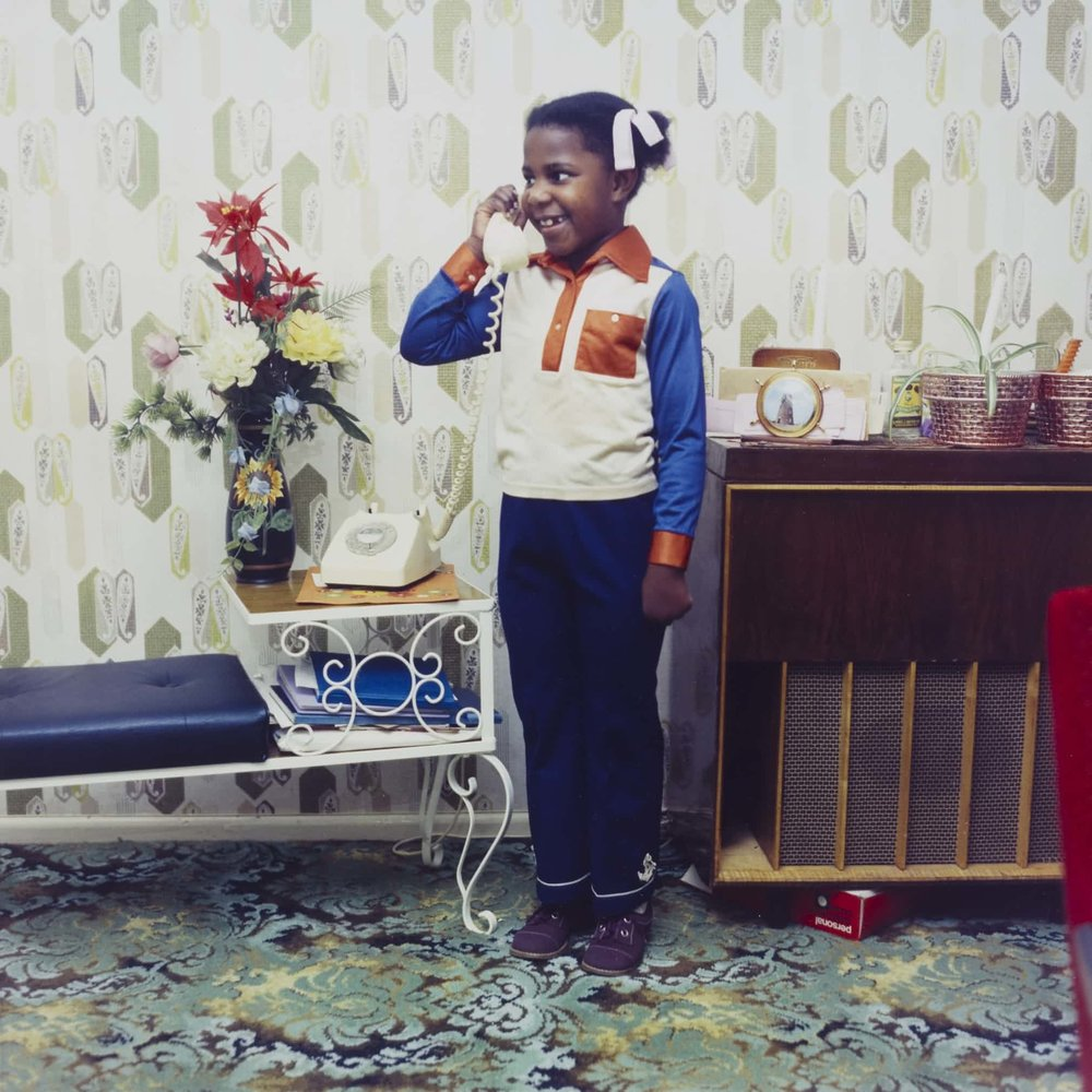 Untitled [A young girl speaking on her parents' telephone in South London], 1973. Photograph: Neil Kenlock/Victoria and Albert Museum