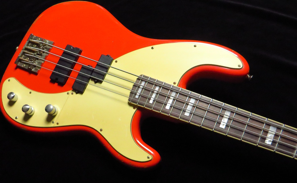 Bodycheck:  - The Fiesta Red Nitro finish on the alder body is wonderfully aged with various dings and dongs in the usual places. The large 51-inspired pickguard has yellowed over the years.