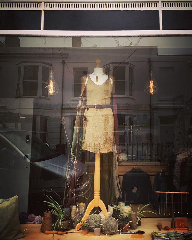 Shop window looking magical ✨ . This lucky lady is dressed from head to toe in linen. Lovely loose knit colour block cardigan with a gorgeous drape silhouette. . Linen and lurex swing dress, cinched with a simple leather belt by @hydewares and accented with a beautiful handmade brass necklace by Gemini Creations. . #wiwt #shopwindow #windowdisplay #ootd #boutiquewindow #ecofashion #supportsmallbusiness #indiefashiondesigner #textilesgraduate #linen #linenknitwear #knittedlinen #linencardigan #linendress #handmadejewellery #handmadeleathergoods #brightongirl #fashionrevolution #shopwindow #handmadeknitwear #bespokeknitwear #summerknitwear #madeinbrighton #madeinbritain