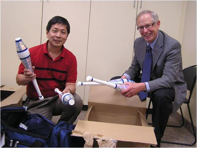 Danny Ying, Edina Youth Juggling Association Treasurer   with  Dick Crockett and new juggling clubs
