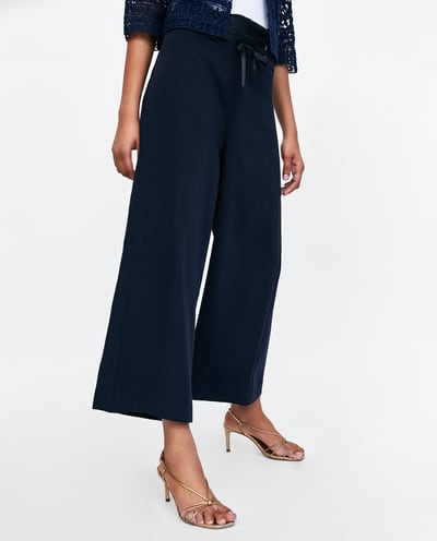 Culottes for the win... - Tailored pants are a work wardrobe staple but let's be real the material isn't always the airiest, well lucky for you, culottes are the trendiest trousers out there and they are easy to dress up or down. Just throw on a t-shirt and you'll still look smart and trendy!