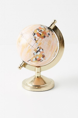 Globe Trotter - Do you often find yourselves daydreaming of being on a Greek island or munching on croissants in Paris while typing on your computer during your 9-5 job? Although you may not be able to hop on a plane right then and there, you can at least feel comforted knowing you have a beautiful globe on your desk.