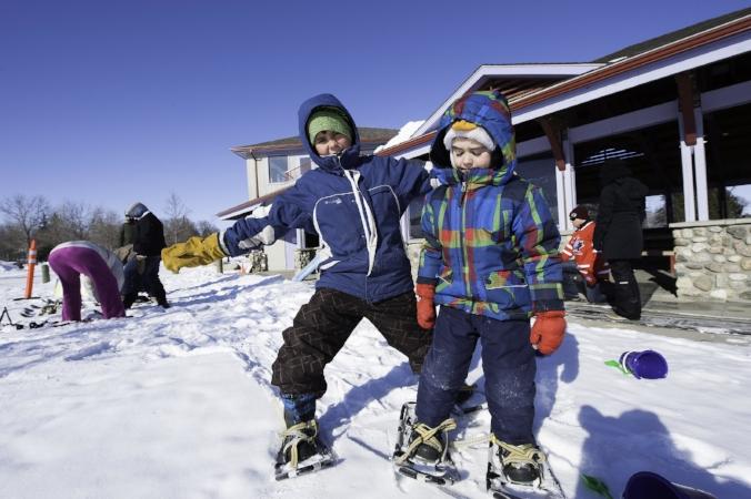 Kids snowshoeing.