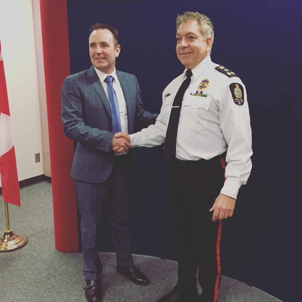 Mayor Tolmie welcoming Police Chief Rick Bourassa on board for another five years